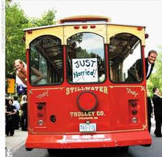 After the ceremony at the charming Nazareth Chapel in St. Paul, the wedding party boarded a trolley for photos in Pioneer Park. Meanwhile, the couple's 150 guests headed to Stillwater's historic courthouse for an all-American outdoor cocktail hour with mi...