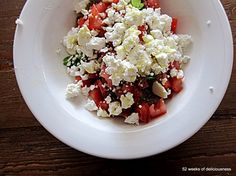 Greek bruschetta = Dakos  Dakos is made of barley and topped with ripe tomatoes, good quality olive oil and feta cheese. Add some herbs and ground pepper.