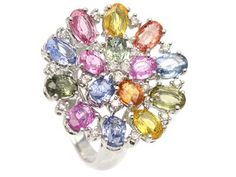 Ring, 18K white gold, 15 oval cut sapphires pink, green, blue, orange and yellow 6,61 ctw, 18 brilliant cut diamonds 0,26 ctw, approx W(H)/SI, size 17,75 mm, weight 6,96 grams. #jewelry #colour #rings
