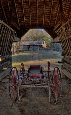 Old Wagon In Barn With View Of Another Barn..The Great Smokey Mountains
