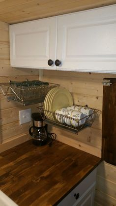 dish drainer also storage (notice bread pan underneath to catch drips) casa-de-la-esperanza-4