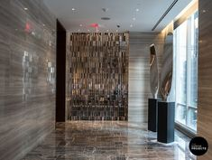 """Installation view of Rob Fischer, """"Propeller Diptych,"""" 2011-2012. Polished aluminum and pedestal 118 x 16 and 112 x 16 inches Special commission for Park Hyatt."""