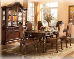 North Shore Dk Opulent Brown Dining Suite Featuring Decorative Pilasters & Ornate Detailed Appliques | Luther Appliance and Furniture
