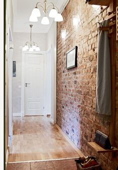 exposed brick wall in the hallway