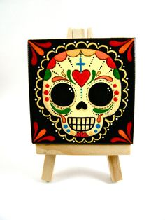Sugar Skull Small Canvas Painting by MyMayanColors on Etsy Original Art by My Mayan Colors (Ruth Barrera). All images are the sole property of My Mayan Colors and not intended for copy Más Sugar Skull Painting, Sugar Skull Art, Sugar Skull Makeup, Sugar Skulls, Small Canvas Paintings, Mini Paintings, Canvas Art, Mexican Skulls, Mexican Folk Art