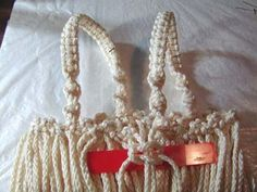 Materials & Supplies Needed To Make Macrame Purse 110 yds of BRAIDED macrame cord (or braided) 20 one inch wooden beads beads front, 10 beads back) knotting board or ceiling tile T-… Macrame Purse, Macrame Cord, Macrame Knots, Macrame Bracelets, Clove Hitch Knot, Macrame Bracelet Tutorial, Macrame Projects, Types Of Bag, Glue Crafts