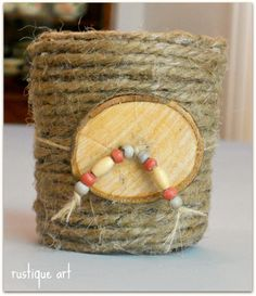 Glass Votive Candle Holder ~attached a wooden button with some burlap string and then added some small wooden beads.  done!