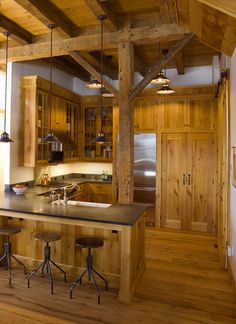 The timber frame is reclaimed hemlock |  The wall boards, trim and cabinetry are reclaimed pine |  The flooring is antique oak...great small barn kitchen...