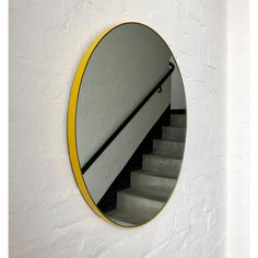 A bespoke round yellow orbis round silver mirror with a yellow frame was created for a client in Sturminster Newton, UK