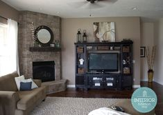 corner fireplace with raised hearth & wood mantle & side angled to wall