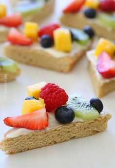 Fruit Pizza      2 cups all purpose unbleached flour (Gold Medal)     1/2 tsp baking soda     1/4 tsp salt     1/8 teaspoon ground cinnamon     2/3 cup granulated sugar     2/3 cup brown sugar, unpacked     1/4 cup melted unsalted butter     2 large egg whites     1/4 cup unsweetened apple sauce     2 tsp vanilla extract     2/3 cup white chocolate chips  For the Frosting:      8 oz 1/3 less fat cream cheese, softened     1/2 cup powdered sugar     1 teaspoon vanilla