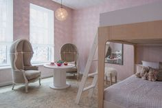 """Envisioned as bedroom for twin girls, there are miniature versions of the chairs at Bergdorf Goodman's restaurant. """"We put a lot of thought into how a family would live,"""" Ruddy says.   - ELLEDecor.com"""