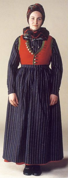 Danish folk dress. I think it is the Fanoe dress, but then again I might be wrong since there are so many different once across the country.