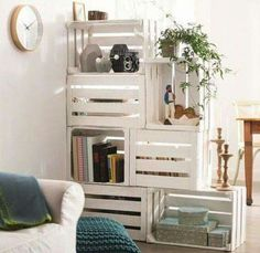 paint crates as storage and room divider. brilliant and lovely.