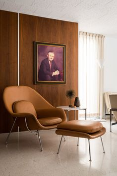 A Knoll Womb Chair is the perfect place to lounge off the living room. The homeowners replaced nine types of flooring—including linoleum and green shag carpeting—with terrazzo tiles and carpet in the bedrooms.