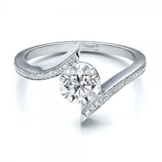 #100285 This beautiful engagement ring was designed by Joseph Jewelry.This engagement ring features a round brilliant cut diamond which is set in between the...