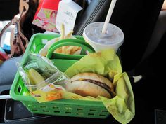 Keep your kids from making a mess when eating in the car by putting their meal into an organization bucket.