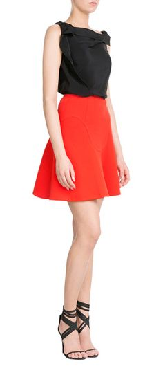 The structured flared hem of this Roland Mouret wool skirt is both feminine and modern. The red color makes it a statement choice, whether you keep it girlish and pretty or style it with a sharp, graphic kick #Stylebop