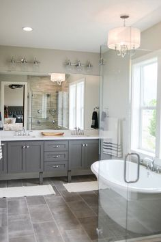 Bathroom floor tile is Reside 12×24 Ash Semi-polished. Faucet: Moen Wynford in Chrome. Bathroom lighting is Three Light Polished Chrome Clear Seeded Glass Vanity by Progress Lighting – $240 each.