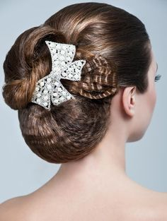 Wedding hair chignon (bun) with rhinestone clip | wedding hairstyles | Wedding Wishes Wedding Guide