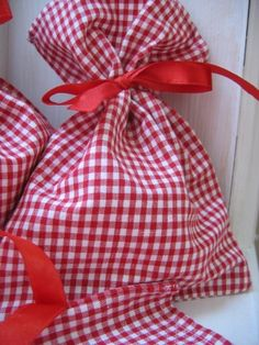 Gingham party bags...on a blue table cloth for a summer birthday treat...