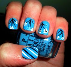 """OPI """"no room for the blues""""  with black & white flowers and stripes"""