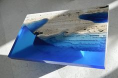 Lagoon Tables Created By Merging Resin With Cut Travertine Marble
