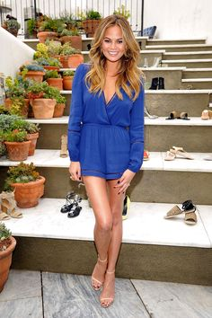 Chrissy Teigen looks hot in a low-cut romper at the RAYE shoe launch event in West Hollywood.