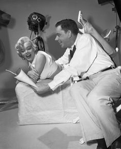 "Marilyn Monroe and Tom Ewell posing in the studio for ""The Seven Year Itch"" 1955"