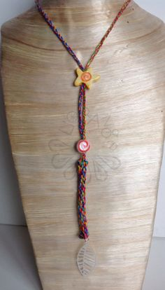 Long braided cotton thread necklace with handmade ceramic pieces and silver plated pendant