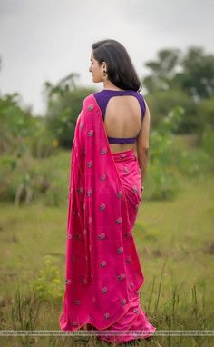 Featuring the Pinkberry modal cotton saree with large flower blooms hand-embroidered with pink pearls and dark green ribbonwork leaves. It comes with a purple unstitched cotton blouse material and an unstitched matching pink cotton petticoat fabric. South Indian Blouse Designs, Blouse Neck Designs, Blouse Patterns, Sari Design, Purple Saree, Purple Blouse, Saree Jackets, Men's Jackets, Stylish Blouse Design
