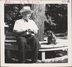 "Mural painter Barry Faulkner (1881– 1966) and his Dachshund ""Slipper"" in Keene, New Hampshire, 1948. Barry Faulkner papers."