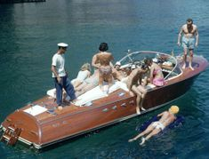 Carla Vuccino and Bianca Volpato holiday with their friends on Capri, Italy, July 1958. Photo by Slim Aarons