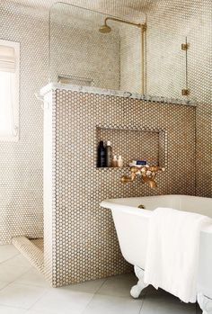 penny tile and clawfoot tub bathroom. brass, rose gold fixtures