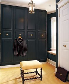 """tommy smythe """"IKEA Pax closet"""" - I gave them a custom look with a few extras: crown moulding and genuine vintage doorknobs instead of pulls. I converted the tiny middle bedroom into a generous walk-in closet that would incorporate a stackable washer and dryer for convenient laundry access."""