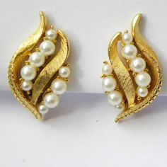 Stylish Grace vintage clip on earrings with white faux pearl and a curved gold colored design Elegant small faux pearls arranged in two biflected lines