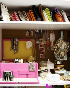 half the bottom self of wardrobe closet to make a mini shelf for purses.