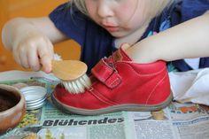 Polishing shoes.