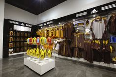 """Davidson (working closely with Huntr Group) developed the branding and fitout of the Hawthorn Football Club HQ and retail outlet – The """"Hawk's Nest.""""   This project involved massive structural reconfiguration, expansion of the store and integration of the museum in the new look and feel. Today, the home of the team is visually impressive and adequately reflects the history, passion and success of the Mighty Hawks!!"""