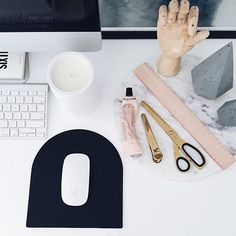 Minimalist desk perfection featuring some of mother nature's finest natural materials and our favourites, concrete, leather + marble. @zakkiahomewares concrete candles available in store and online and @doweljones leather mouse pad & ruler available in store and online shortly. Image capture and styling by @katie_paterson of @simple.form