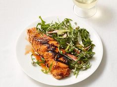 Swap in fish for chicken wings to make this Buffalo-Style Salmon. It's glazed with a sweet and spicy maple syrup and hot sauce mixture and served with an elegant blue cheese and arugula salad.