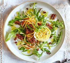 This extra-special vegetarian starter is bursting with contrasting flavours and textures, such as spiralized pear, crunchy roasted nuts and creamy cheese