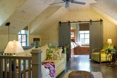 Great use of attic space and I love the sliding barn doors.