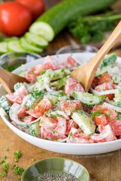 Creamy Cucumber Tomato Salad is the perfect side salad for any time of year and is packed with juicy ripe tomatoes, crisp cucumbers and fresh herbs!