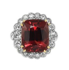 Orangy Red Spinel and Diamond Ring   18 kt. white and yellow gold, one cushion-shaped orangy-red spinel ap.7.55 cts., 18 diamonds ap. .85 ct. Size 5 1/2.