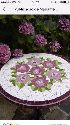 Mosaic patio table top with roses.I love how the roses are composed of small triangles.I love all things purpleFinally You can use your broken plates or tales =) Mosaic Tile Art, Mosaic Crafts, Mosaic Projects, Mosaic Glass, Glass Art, Mosaic Designs, Mosaic Patterns, Mosaic Patio Table, Mosaic Furniture