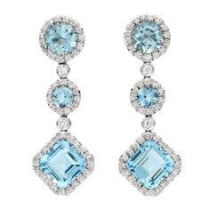 Favero Aquamarine & Diamond Dangle Earrings, set in 18Kt White Gold and feature 6 Mixed Cut Aquamarines for approximately 6.96cts accented by approximately 0.62cts of Round Brilliant Cut Diamonds. Earrings weigh 12.38 grams, and measure 13mm (wide) x 37mm (long).Italy. 21st Century