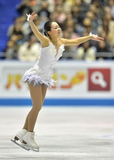 This photo taken on April 13, 2013 shows Vancouver Olympic silver medallist Mao Asada performing in the women's free skating event at the World Team Trophy figure skating competition in Tokyo. Japanese figure skating star Mao Asada, the 2008 and 2010 world champion, said on April 14, 2013 she would retire from competition after next year's Sochi Winter Olympics.