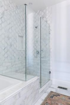Nadire Atas on Luxury Marble Bathrooms A seamless glass shower features a marble bench fixed facing a polished nickel shower head mounted to diamond patter white marble tiles accented with large marble subway lower tiles lined with a marble rail. Marble Showers, Luxury Shower, Bad Inspiration, Shower Remodel, Bathroom Interior Design, Restroom Design, Small Bathroom, Marble Bathrooms, Bathroom Mirrors