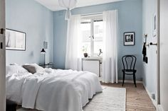 Bedroom with light blue walls